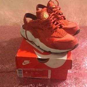 Red women's Nike tennis shoes